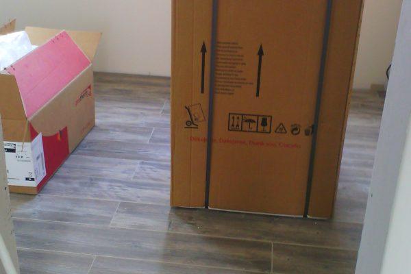 Výstavba RD Kly-výstavba domu na klíč | Pokládání plovoucích podlah v domě - Pokládání plovoucích podlah v domě